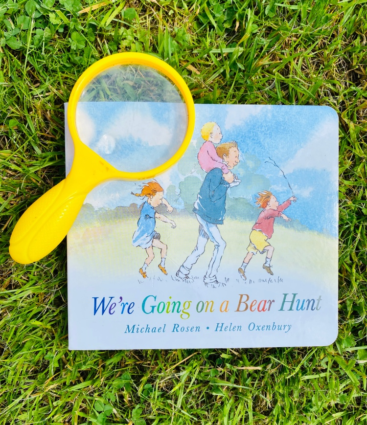We're going on a bear hunt book with magnifying glass